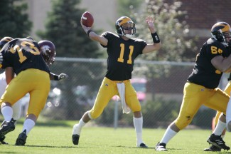 Gustavus quarterback throws down the field.