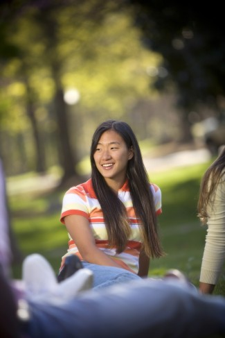 Young woman enjoys class outside.