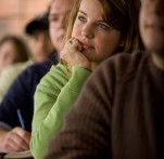 A young woman ponders in class.