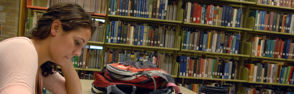 Student in Library at Concordia College, Moorhead