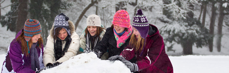 Students Making a Snowman at Pacific Lutheran University
